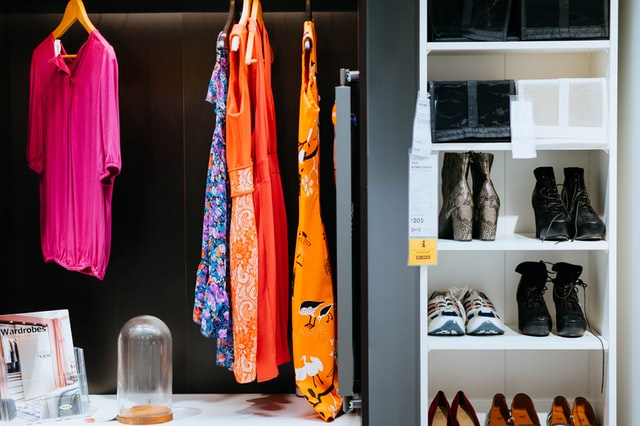bold color clothes in closet